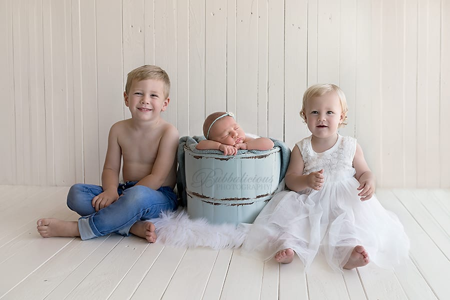 Newborn in a light blue tub with big brother and sister - Sunshine Coast Gympie Newborn Photography