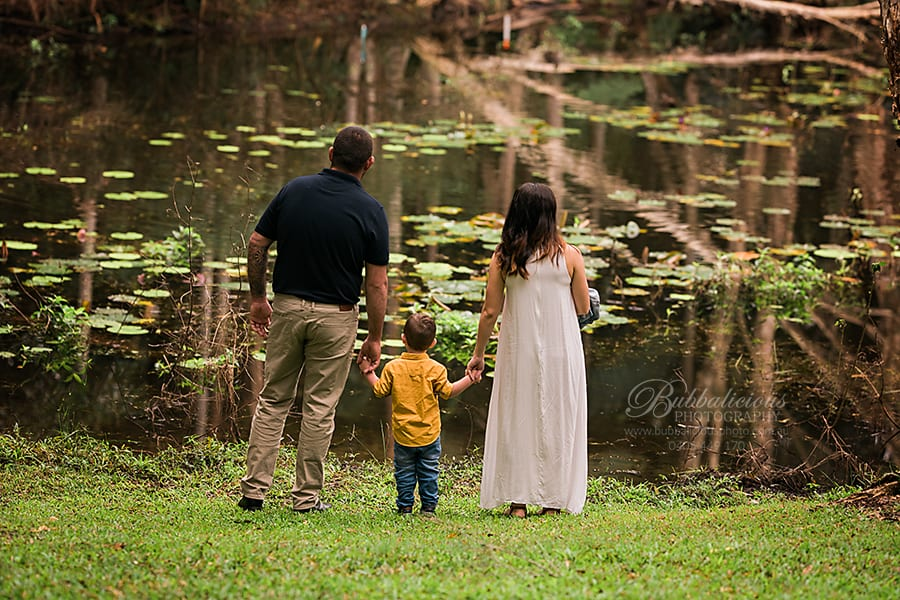 Family looking out at the pond - Noosa Botanical Gardens - Sunshine Coast Gympie Maternity Photographer