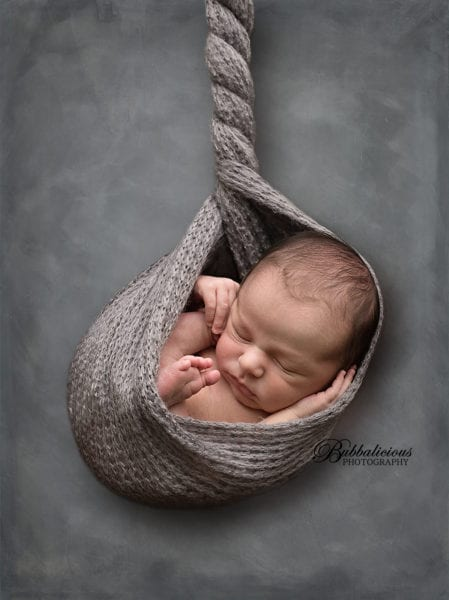 This hanging shot is done safely and uses the combination of posing and photoshop to achieve the final result - Sunshine Coast Gympie Newborn Photographer