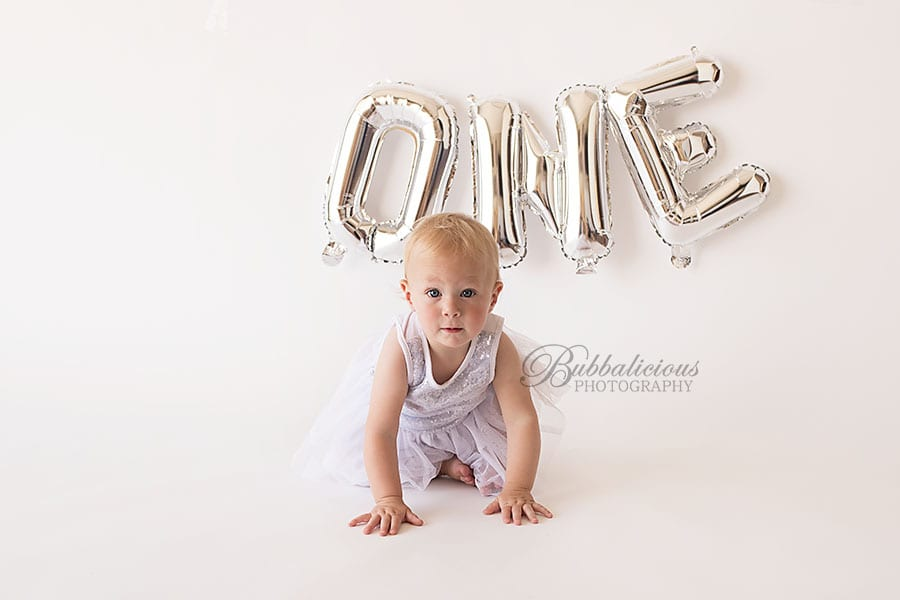 Crawling toddler in a white dress just turned one - Sunshine Coast Gympie Baby Photographer
