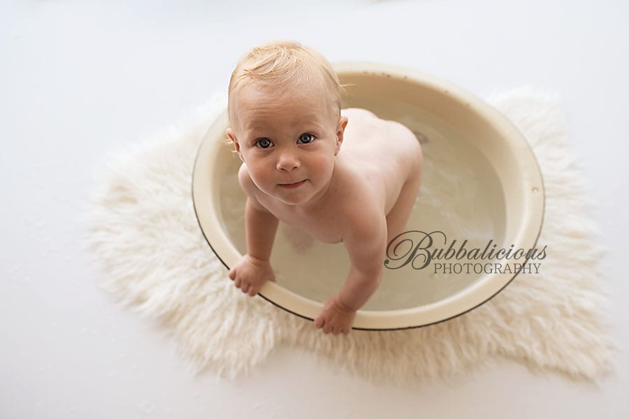 Toddler standing up in an antique bathtub - Sunshine Coast Gympie Baby Photographer