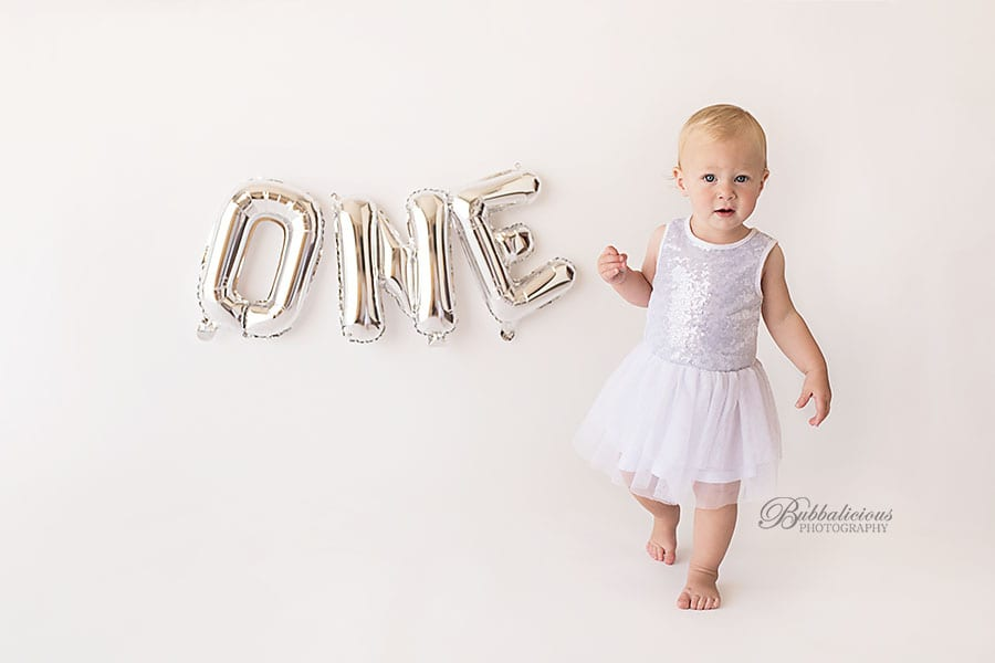 Toddler in a white dress just turned one - Sunshine Coast Gympie Baby Photographer