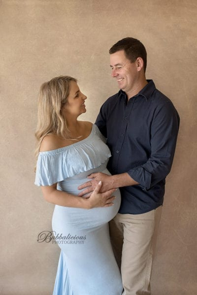 Baby girl in tummy, parents smiling at each other, pregancy photo - Sunshine Coast Gympie Region Premium Maternity Photographer