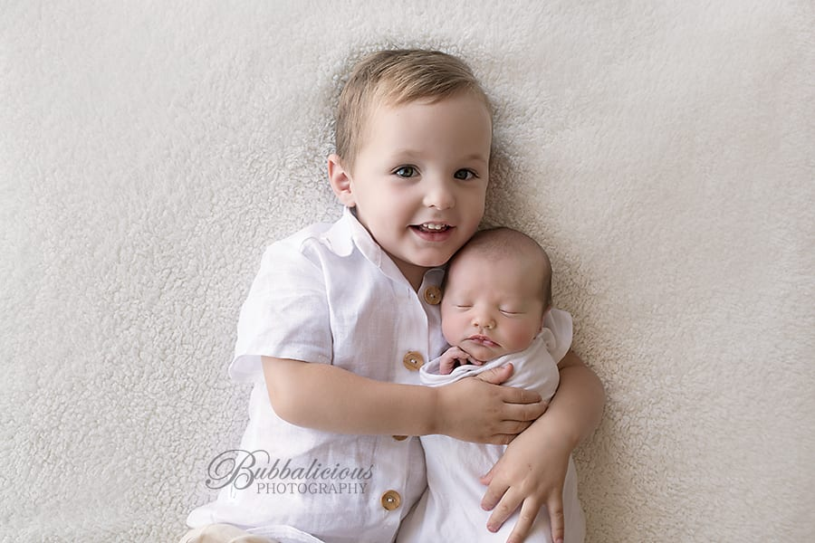 Young boy hugging his baby sister - Sunshine Coast Gympie Newborn Photographer