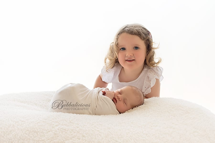 Big sister thinks her baby sister is OK - Sunshine Coast Gympie Newborn Photographer