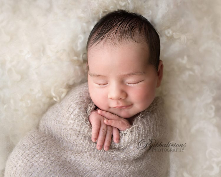 Newborn with a cheeky little smile - Sunshine Coast Gympie Newborn Photographer