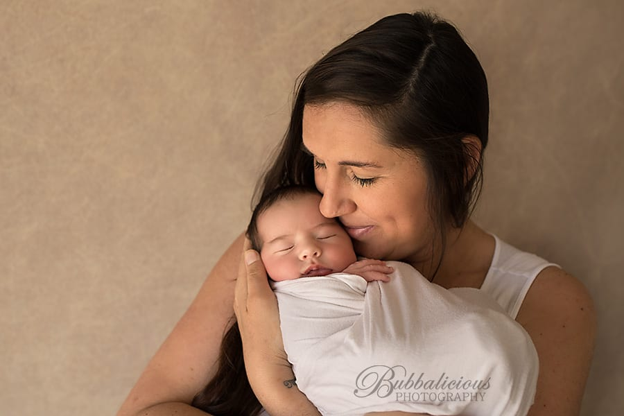 Mum holding her newborn close to her face - Sunshine Coast Gympie Newborn Photographer
