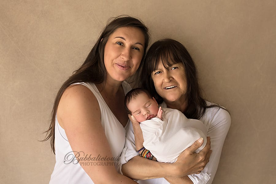 Newborn held by mum and grandmother - Sunshine Coast Gympie Newborn Photographer