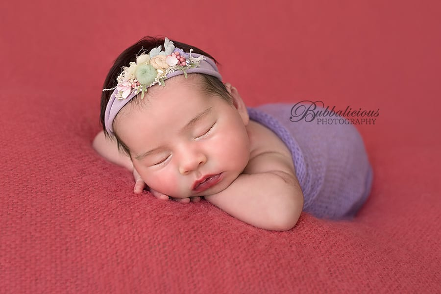 Beautiful closeup of a newborn in lilac knit with floral headband - Sunshine Coast Gympie Newborn Photographer