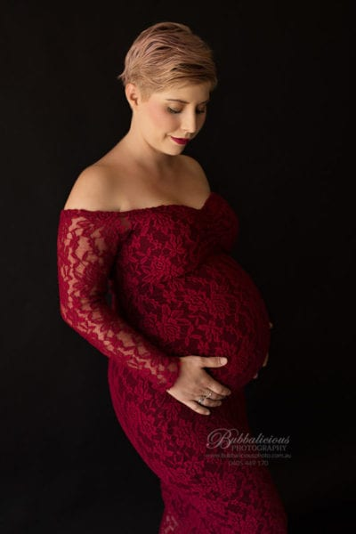 Red Maternity dress on black background, woman 36 weeks pregnant - Sunshine Coast Gympie Region Premium Pregnancy Photographer