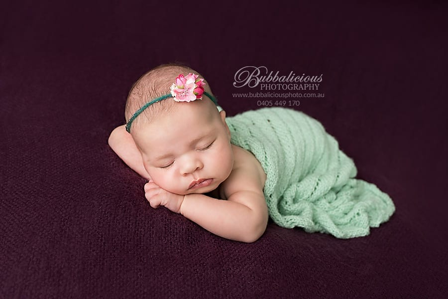 Newborn with flower - Purple and Mint - Bubbalicious Photography - Premium Newborn Photographer - Sunshine Coast Gympie