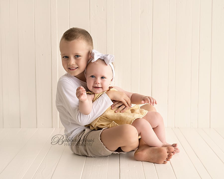 Big brother cuddling baby sister - Premium Family Photographer - Sunshine Coast Gympie Region