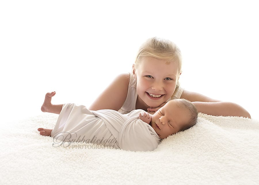 Big sister welcomes her little sister smiling! - Sunshine Coast Gympie Region Premium Newborn Photographer