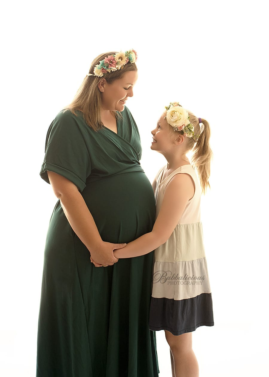 Pregnant mum connecting with older daughter - Sunshine Coast Gympie Region Premium Maternity Photographer